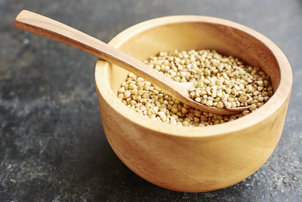 Hemp seeds in a wooden bowl.