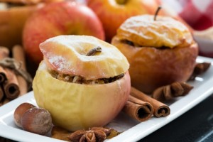 baked stuffed apples on a plate, close-up, horizontal