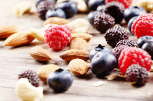 Nuts and berries on the wooden table