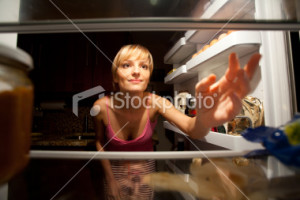 woman-kitchen16216105-woman-reaching-for-food-in-refrigerator-at-night